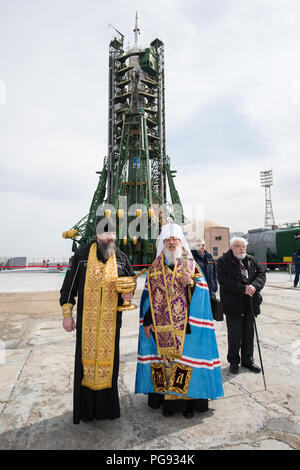 An Orthodox Priest blesses members of the media at the Baikonur Cosmodrome launch pad, Tuesday, March 20, 2018 in Baikonur, Kazakhstan. Expedition 55 Soyuz Commander Oleg Artemyev of Roscosmos, Ricky Arnold and Drew Feustel of NASA are scheduled to launch to the International Space Station aboard the Soyuz MS-08 spacecraft on Wednesday, March, 21. - Stock Photo