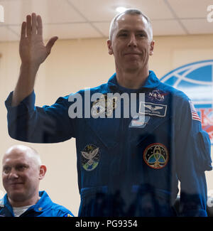 Expedition 55 flight engineer Drew Feustel is seen in quarantine, behind glass, during a press conference, Tuesday, March 20, 2018 at the Cosmonaut Hotel in Baikonur, Kazakhstan. Feustel, Soyuz Commander Oleg Artemyev of Roscosmos, and flight engineer Ricky Arnold of NASA are scheduled to launch to the International Space Station aboard the Soyuz MS-08 spacecraft on Wednesday, March, 21. - Stock Photo