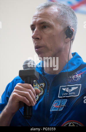 Expedition 55 flight engineer Drew Feustel of NASA answers a question during a press conference, Tuesday, March 20, 2018 at the Cosmonaut Hotel in Baikonur, Kazakhstan. Feustel, Soyuz Commander Oleg Artemyev of Roscosmos, and flight engineer Ricky Arnold of NASA are scheduled to launch to the International Space Station aboard the Soyuz MS-08 spacecraft on Wednesday, March, 21. - Stock Photo