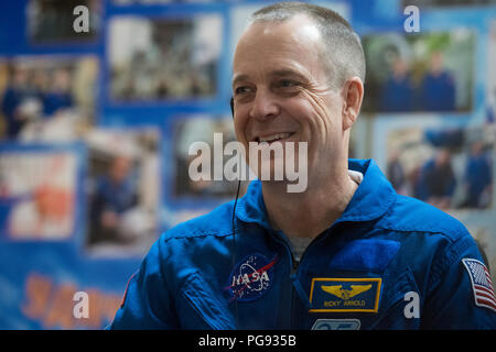 Expedition 55 flight engineer Ricky Arnold of NASA is seen in quarantine, behind glass, during a press conference, Tuesday, March 20, 2018 at the Cosmonaut Hotel in Baikonur, Kazakhstan. Arnold, Soyuz Commander Oleg Artemyev of Roscosmos, flight engineer Drew Feustel of NASA are scheduled to launch to the International Space Station aboard the Soyuz MS-08 spacecraft on Wednesday, March, 21. - Stock Photo