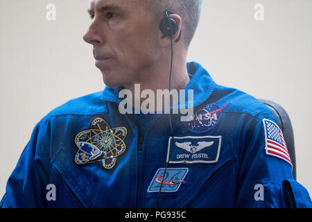 Expedition 55 flight engineer Drew Feustel of NASA is seen in quarantine, behind glass, during a press conference, Tuesday, March 20, 2018 at the Cosmonaut Hotel in Baikonur, Kazakhstan.  Feustel, Oleg Artemyev of Roscosmos, and flight engineer Ricky Arnold of NASA are scheduled to launch to the International Space Station aboard the Soyuz MS-08 spacecraft on Wednesday, March, 21. - Stock Photo