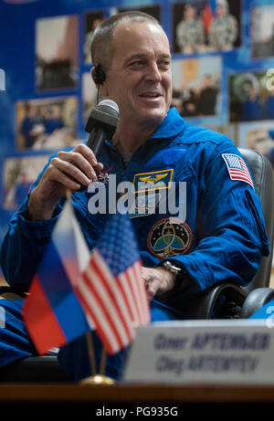 Expedition 55 flight engineer Ricky Arnold answers a question during a press conference, Tuesday, March 20, 2018 at the Cosmonaut Hotel in Baikonur, Kazakhstan. Arnold, Soyuz Commander Oleg Artemyev of Roscosmos, and flight engineer Drew Feustel of NASA are scheduled to launch to the International Space Station aboard the Soyuz MS-08 spacecraft on Wednesday, March, 21. - Stock Photo