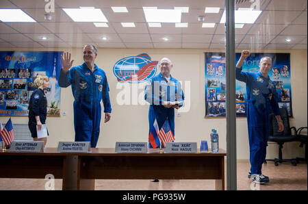 Expedition 55 flight engineer Ricky Arnold of NASA, left, Soyuz Commander Oleg Artemyev of Roscosmos, center, and flight engineer Drew Feustel of NASA, right, are seen at the conclusion of a press conference, Tuesday, March 20, 2018 at the Cosmonaut Hotel in Baikonur, Kazakhstan. Arnold, Artemyev, and Feustel are scheduled to launch to the International Space Station aboard the Soyuz MS-08 spacecraft on Wednesday, March, 21. - Stock Photo
