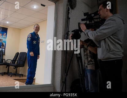 Expedition 55 flight engineer Ricky Arnold of NASA is seen at the conclusion of a press conference, Tuesday, March 20, 2018 at the Cosmonaut Hotel in Baikonur, Kazakhstan. Arnold, Soyuz Commander Oleg Artemyev of Roscosmos, and flight engineer Drew Feustel of NASA are scheduled to launch to the International Space Station aboard the Soyuz MS-08 spacecraft on Wednesday, March, 21. - Stock Photo