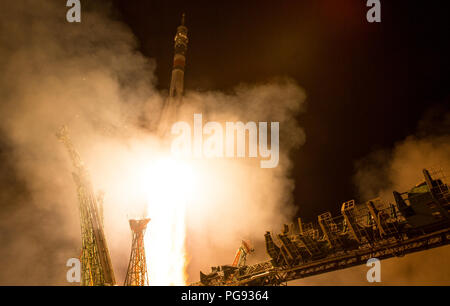 The Soyuz MS-08 rocket is launched with Expedition 55 Soyuz Commander Oleg Artemyev of Roscosmos and flight engineers Ricky Arnold and Drew Feustel of NASA, Wednesday, March 21, 2018 at the Baikonur Cosmodrome in Kazakhstan. Artemyev, Arnold, and Feustel will spend the next five months living and working aboard the International Space Station. - Stock Photo