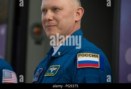 Expedition 55 Soyuz Commander Oleg Artemyev of Roscosmos is seen as he and fellow crewmates Ricky Arnold and Drew Feustel of NASA depart the Cosmonaut Hotel to suit-up for their Soyuz launch to the International Space Station, Wednesday, March 21, 2018 in Baikonur, Kazakhstan. Arnold, Artemyev, and Feustel launched aboard the Soyuz MS-08 spacecraft at 1:44 p.m. Eastern time (11:44 p.m. Baikonur time) on March 21 to begin their journey to the International Space Station. - Stock Photo