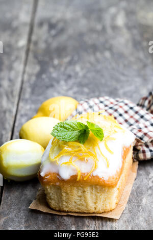Homemade  lemon loaf on wooden table - Stock Photo