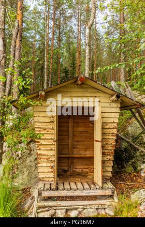 Deatil of an old wooden changing cabin on the shore of the Saimaa lake in Finland - 1 - Stock Photo