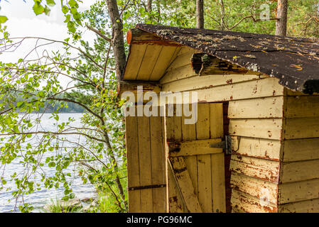 Deatil of an old wooden changing cabin on the shore of the Saimaa lake in Finland - 2 - Stock Photo