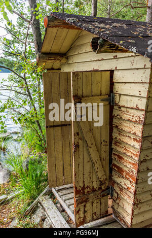 Deatil of an old wooden changing cabin on the shore of the Saimaa lake in Finland - 3 - Stock Photo