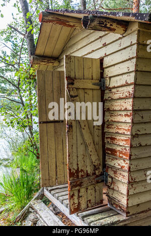 Deatil of an old wooden changing cabin on the shore of the Saimaa lake in Finland - 4 - Stock Photo