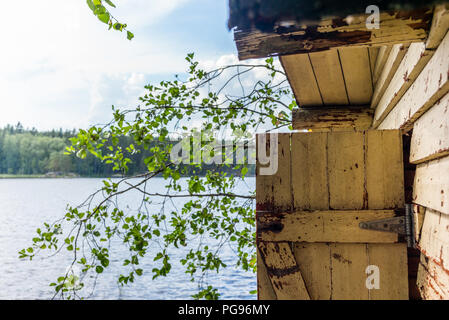 Deatil of an old wooden changing cabin on the shore of the Saimaa lake in Finland - 5 - Stock Photo