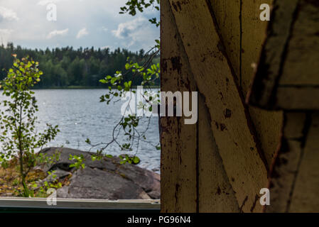 Deatil of an old wooden changing cabin on the shore of the Saimaa lake in Finland - 6 - Stock Photo