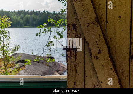 Deatil of an old wooden changing cabin on the shore of the Saimaa lake in Finland - 7 - Stock Photo
