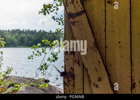 Deatil of an old wooden changing cabin on the shore of the Saimaa lake in Finland - 8 - Stock Photo
