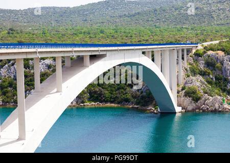 bridge over the sea strait in Croatia - Stock Photo