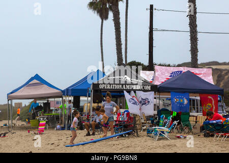 Volunteers and patrons host the 12th Annual Operation Amped Surf Camp at San Onofre Beach at Marine Corps Base Camp Pendleton, California, Aug. 18, 2018. Operation Amped began in September 2006. To find out more information, visit http://operationamped.org (U.S. Marine Corps photo by Lance Cpl. Noah Rudash) - Stock Photo