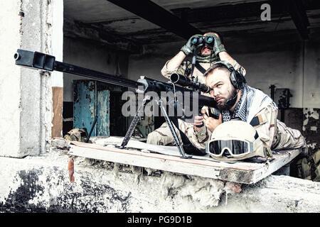 Sniper team with large caliber rifle in ambush - Stock Photo