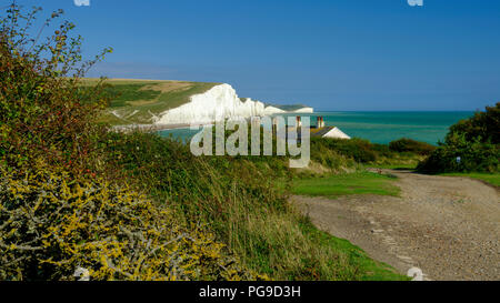 Summer afternoon light on the Severn Sisters white cliffs and the Coast Guard cottages at Cuckmere, in the South Downs National Park, East Sussex, UK - Stock Photo