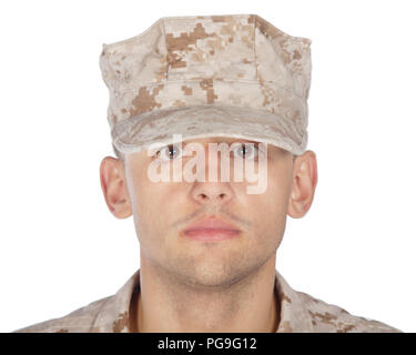 Saluting and smiling army soldier studio shoot - Stock Photo