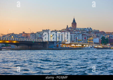 The Galata Bridge over Golden Horn in Istanbul at night, Turkey - Stock Photo