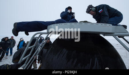 Russian Search and Rescue teams arrive at the Soyuz MS-06 spacecraft shortly after it landed with Expedition 54 crew members Joe Acaba and Mark Vande Hei of NASA and cosmonaut Alexander Misurkin near the town of Zhezkazgan, Kazakhstan on Wednesday, Feb. 28, 2018 (February 27 Eastern time.)  Acaba, Vande Hei, and Misurkin are returning after 168 days in space where they served as members of the Expedition 53 and 54 crews onboard the International Space Station. - Stock Photo