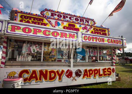 Cheboygan, Michigan, USA - August 9, 2018: Junk food concession booth at the Cheboygan County Fair in northern Michigan. - Stock Photo