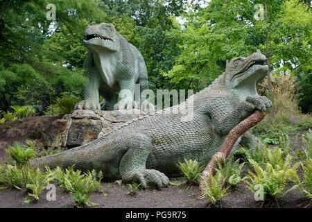 Iguanodon sculptures at Crystal Palace Park, London - Stock Photo