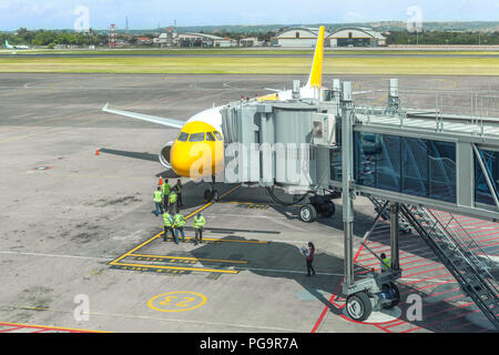 Preparation of a passenger aircraft by ground services at the airport. Disembarkation of passengers through teletrap. - Stock Photo