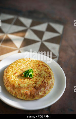 spanish tortilla omelet traditional tapas food on traditional rustic old tiles background in seville - Stock Photo