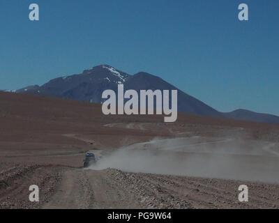 Four wheeler cars drive off-road on plato Altiplano, Bolivia. - Stock Photo