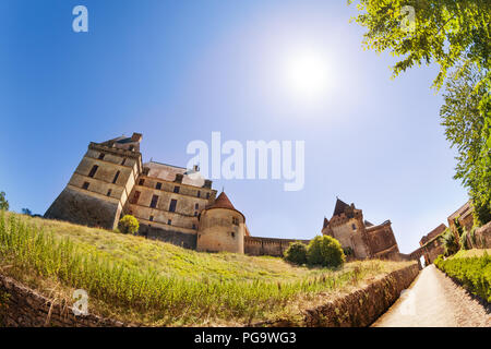 View of Chateau de Biron castle at sunny day - Stock Photo