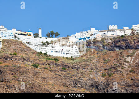 View from a boat to the village of Imerovigli in Santorini, Greece. - Stock Photo