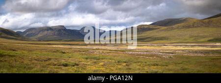 Panoramic view of mountains from Loch Glascarnoch in the Scottish Highlands - Stock Photo