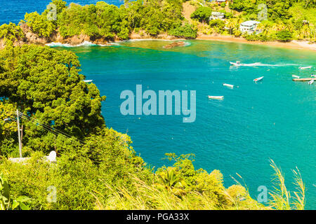 Tobago, Parlatuvier Bay on the tropical island of Tobago in the Caribbean.  A picture postcard bay with turquoise seas and golden beaches - Stock Photo