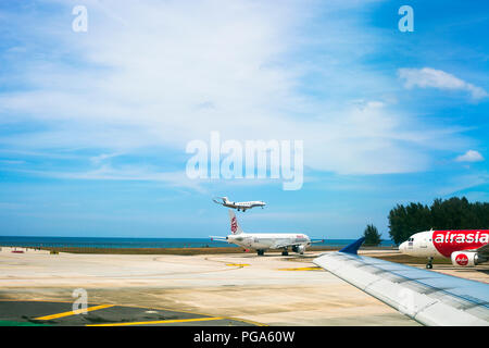 Phuket, Thailand - 20 February 2018: Airport with flying airplane. Airport near beach of Andaman sea - Stock Photo
