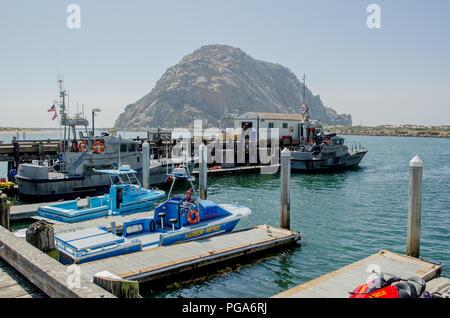 Coast Guard harbor patrol boats and dock, Morro Bay CA - Stock Photo