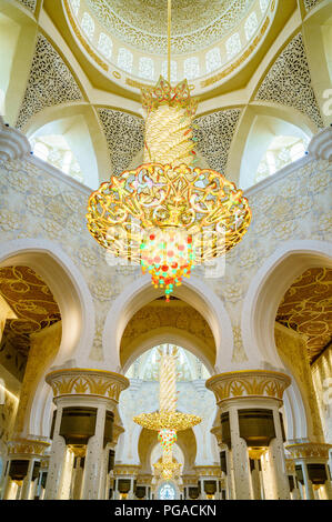 Grand chandelier and interior details of  Sheikh Zayed Grand Mosque in Abu Dhabi, UAE - Stock Photo
