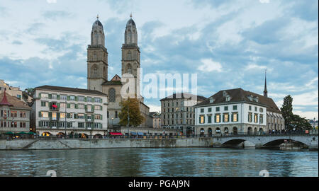 Zurich, Switzerland - September 27, 2017: buildings of the historic part of the city of Zurich along the Limmat river, towers of the Grossmunster cath - Stock Photo