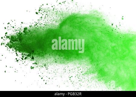 Freeze motion of Green powder exploding on white background. - Stock Photo
