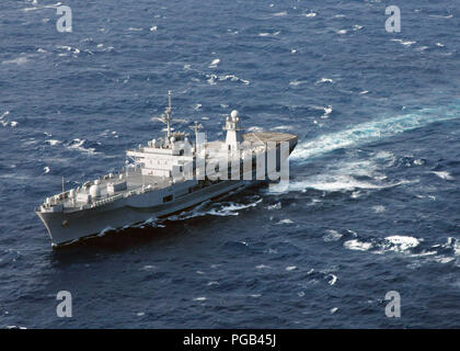 Aerial port bow view of the US Navy (USN) Amphibious Command Ship, USS BLUE RIDGE (LCC 19), underway in the South China Sea during a two-month regularly scheduled deployment. - Stock Photo