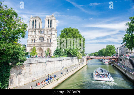 Paris, France - June 23 2018: Parvis Notre-Dame - Jean-Paul-II square and Seine River in Paris, France. - Stock Photo