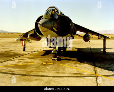 A front view of a Marine AV-8 Harrier aircraft with an AIM-9 Sidewinder missile mounted on the right wing. - Stock Photo