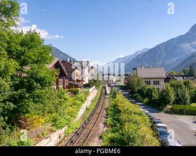 CHAMONIX, HAUTE SAVOIE, FRANCE AUGUST 23, 2018: Aiguille du midi train station on a beautiful summer day. Early morning mist lingers. - Stock Photo
