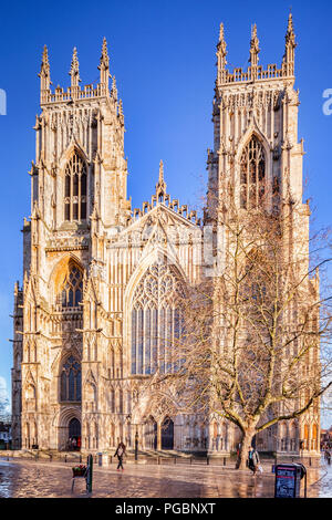 The West facade of York Minster, seen in winter after a shower, with beautiful clear blue sky. - Stock Photo