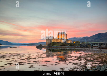 Eilean Donan Castle illuminated at twilight, Highland, Scotland, UK - Stock Photo