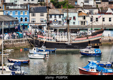 23 May 2018: Brixham, Devon, UK - The harbour with the replica Golden Hind on a fine spring day. - Stock Photo