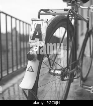 1940s bicycle. In sweden bicycles used registration signs with the owners name and registration number, as a sign of the owner having paid their bicycle tax. Sweden 1940s  Photo Kristoffersson A51-3 - Stock Photo