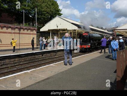 Flying scotsman steam locomotive arriving at bury railway station platform on the east lancashire railway, passengers taking photographs uk - Stock Photo