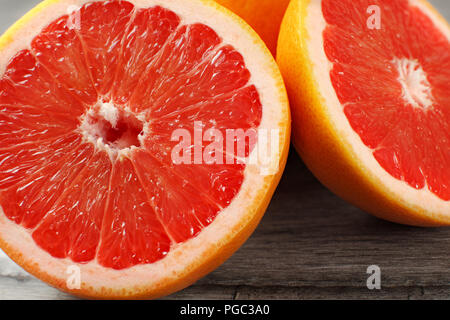 Close up of red grapefruit cut in half - Stock Photo